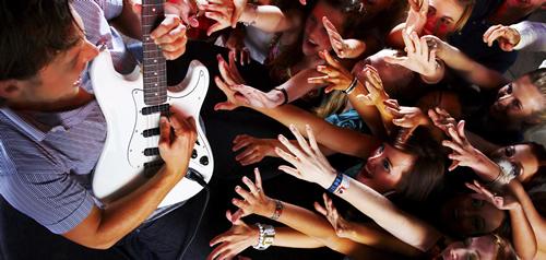 Guitarist and fans YURI ARCURS via istock
