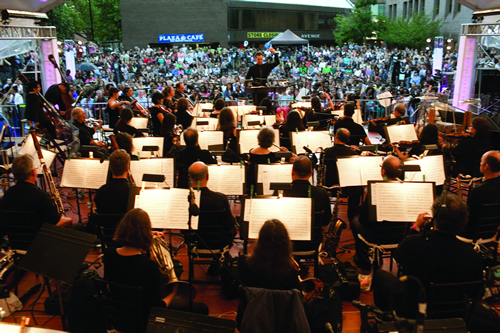 "The Brooklyn Philharmonic (pictured above at an outdoor concert last year) is being sued by composer Nathan Currier over its alleged failure to finish a 2004 performance of the composer's piece ""Gaian Variations"" at Lincoln Center. Photo: Dave Sanders @ Brooklyn Philharmonic"