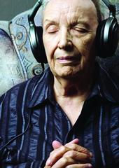 Elderly person listening  KUZMA istock