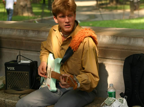 "Under a new ""clarification"" of city parks regulations, musicians who want to collect donations in city parks must confine themselves to certain areas. Above, a guitarist called Gypsy Joe Hocking performs in Central Park."
