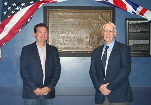 """The Titanic musicians' plaque looks great after some cleanup. Pictured are Douglass Turner (left) and Charles Haas, the president of the Titanic International Society. Turner recovered the plaque from a junkyard after it was inadvertently abandoned by Local 802 in NYC and ended up in Florida. The plaque currently resides at the """"Titanic: The Experience"""" exhibition in Orlando."""