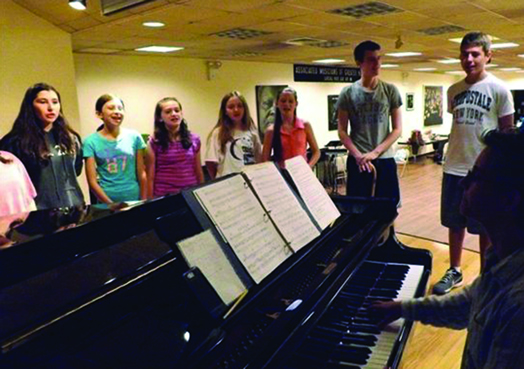 Students at Summer Stock Jr. practice their musical instruments under the capable rehearsal direction of Local 802 member BJ Gandalfo. The program is in its fourth year.