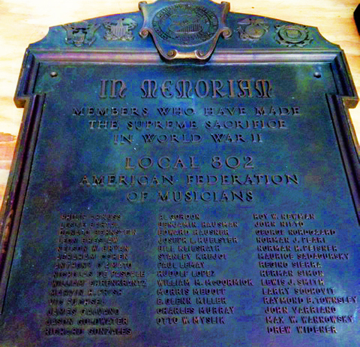 "WE REMEMBER: Thanks to union counsel Harvey Mars, we recently recovered this plaque honoring Local 802 members ""who have made the supreme sacrifice in World War II."" This historic plaque will be unveiled and hung in the union offices."