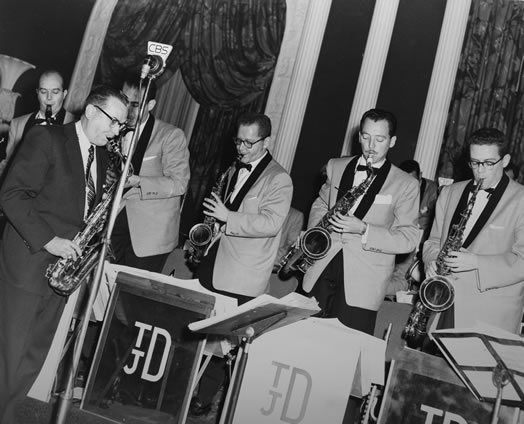 "Jimmy Dorsey at left (in black suit) and Red Press, third from the right. ""Nothing matches the thrill that I had when I was playing with Tommy Dorsey's band."""