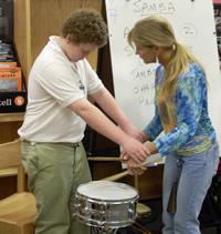 Nanette Ledet helps a blind student get a feel for playing snare.