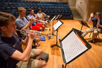 David Krauss, principal trumpet with the Metropolitan Opera Orchestra, instructs the National Youth Orchestra trumpet section on articulation. Photo by Chris Lee.