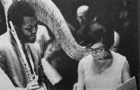 The late harpist Gloria Agostini consults with flutist Harold Jones during a rehearsal.