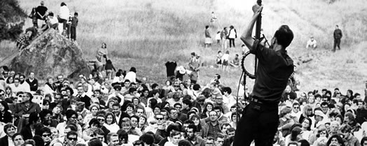 "Pete Seeger performing in a scene from the movie ""Pete Seeger: The Power of Song."""