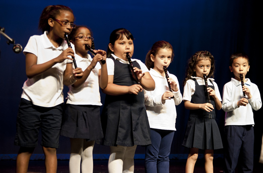 One huge focus of the work of the Bronx Arts Ensemble is arts education in the schools. These photos show Bronx Arts teachers and students in action, sharing with each other the love of music. Photos courtesy of the Bronx Arts Ensemble.