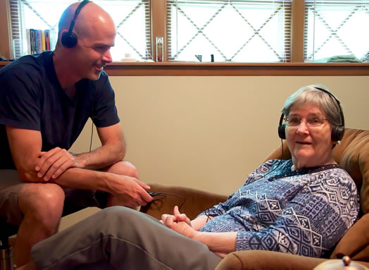 The author and his mother, an Alzheimer's patient, experiencing the joy of music.
