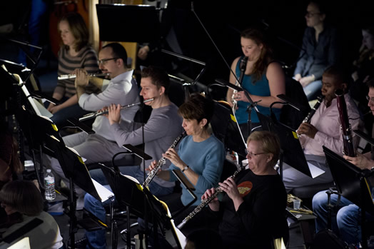 FINE TUNING: The woodwind section of the Met Opera at a recent rehearsal. Elaine Douvas pictured in blue shirt. (Photo: Jonathan Tichler)