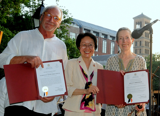NYC Council Member Margaret Chin (middle) hands out official citations of appreciation to Lutz Rath (festival music director and conductor) and Peggy Friedman (executive director of the festival).