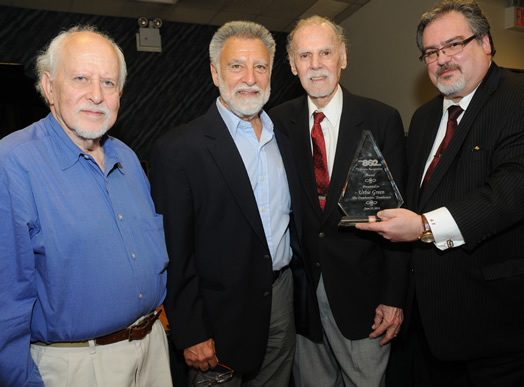 CELEBRATING A LEGEND: Local 802 honored trombone master Urbie Green at a special reception at the union in late June. From left, Dick Lieb, Marvin Stamm, Urbie Green and Local 802 President Tino Gagliardi presenting a plaque to Urbie. Photo: Steve Singer