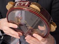 Playing the Arabic tambourine called the riqq
