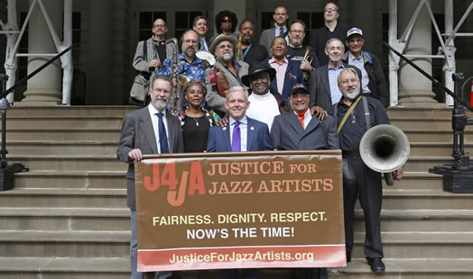 Jazz musicians and union staff are in high spirits after City Council voted to support Justice for Jazz Artists. Photo: Kate Glicksberg.
