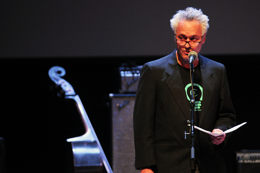 Local 802 member Marc Ribot tells a packed audience about how tech companies like Google exploit the talent of musicians. Photo: Steve Singer