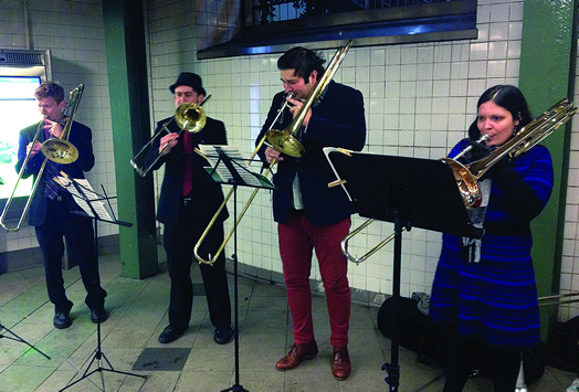 THE JOY OF BUSKING: From left, Jacob Elkin, Ric Becker, David Whitwell and Becca Patterson play on a subway platform.