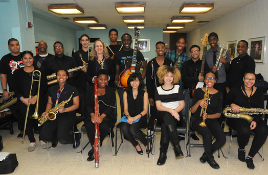 THE NEXT GENERATION: Local 802 member Janet Grice (standing above the bassoonist) teaches music at the Fordham School for the Arts in the Bronx. The student musicians in this article were photographed at a recent concert that the Fordham jazz band gave at Lehman College. Photos by Walter Karling.