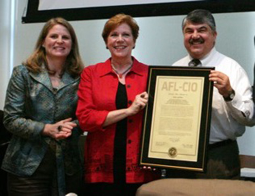 Roberta Reardon receiving the official charter of the new SAG-AFTRA merged union.