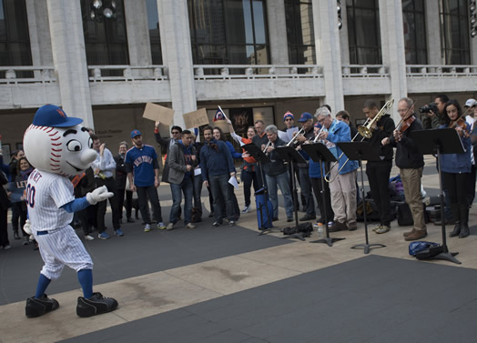 "MR. MET MEETS THE MET ORCHESTRA: On the morning of game #1 of the World Series, Mr. Met came to the steps of Lincoln Center to rally with the Met Orchestra, which performed ""Meet the Mets,"" in an arrangement by Met trumpeter Peter Bond that was conducted by Mr. Met himself. The event was organized by Susan Spector, second oboist of the Met Orchestra since 1992 and a die-hard Mets fan, and Lincoln Center security guard Avo Asencio, who has a cousin who works in the Mets' marketing department."