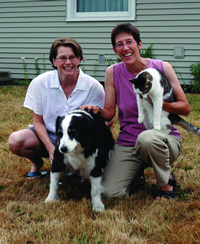 Mary Whitaker (left) and her partner Suzanne Gilman, with dog Bridey and cat Tosca. Photo by Roy Lewis.
