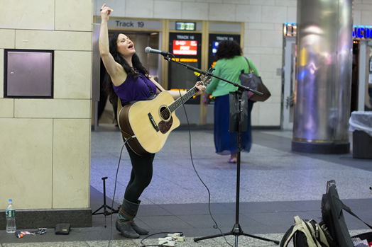 Nicola Vazquez has had an amazing experience busking in the subway. Photo: Bryan Close