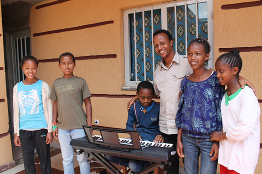 Biniyam Bekele teaches piano, guitar and bass guitar to students at Lelt's Community Center.