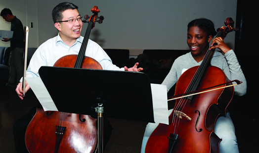 """New York Philharmonic cellist Qiang Tu with an """"All Star"""" student."""