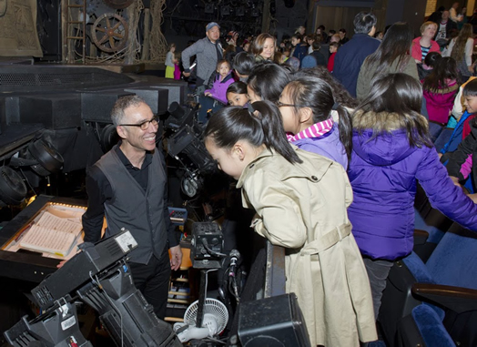 """Ric Molina shows visiting NYC public school children the mysteries of the orchestra pit at """"Wicked."""" Photo: Elena Olivo"""