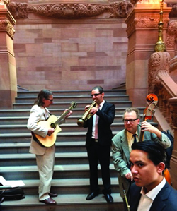 Musicians from AFM Local 14 warm up before performing at a press conference outside the Capitol Building in Albany in support of the Empire State Music Production Tax Credit.
