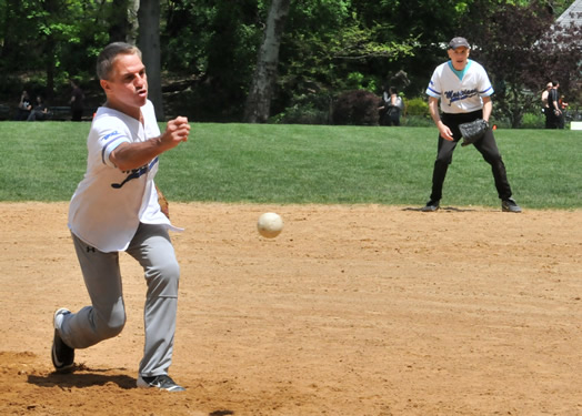 Tony Danza pitches a fastball, while Pat Milando watches in amazement.