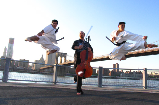 As part of his eclectic career, Dave Eggar (who is also a black belt) tours with karate practitioners in a live music and karate show.
