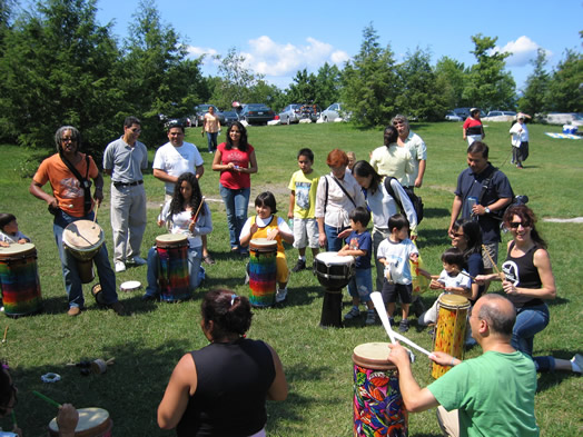 Local 802 members Bashiri Johnson (with mallets at far left) and Valerie Ghent (far right) at a Feel the Music drumming workshop.