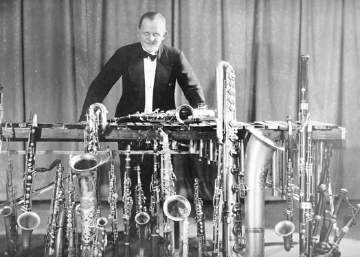 "Check out that woodwind collection - now that's doubling! Ross Gorman (above) was one of the wind doublers in Paul Whiteman's orchestra and was the clarinetist who initially performed the famous opening of Gershwin's ""Rhapsody in Blue."" Photo courtesy of Sheila Gorman."